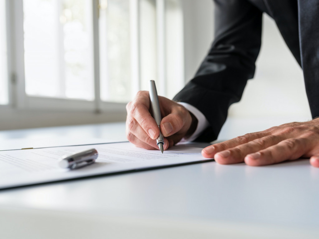 Businessman in office signing contract