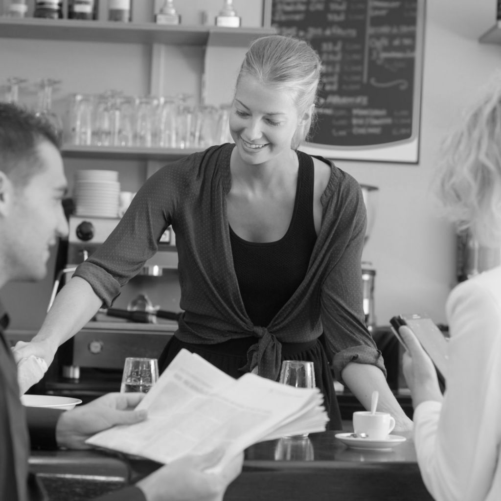 a waitress serving a couple of customers