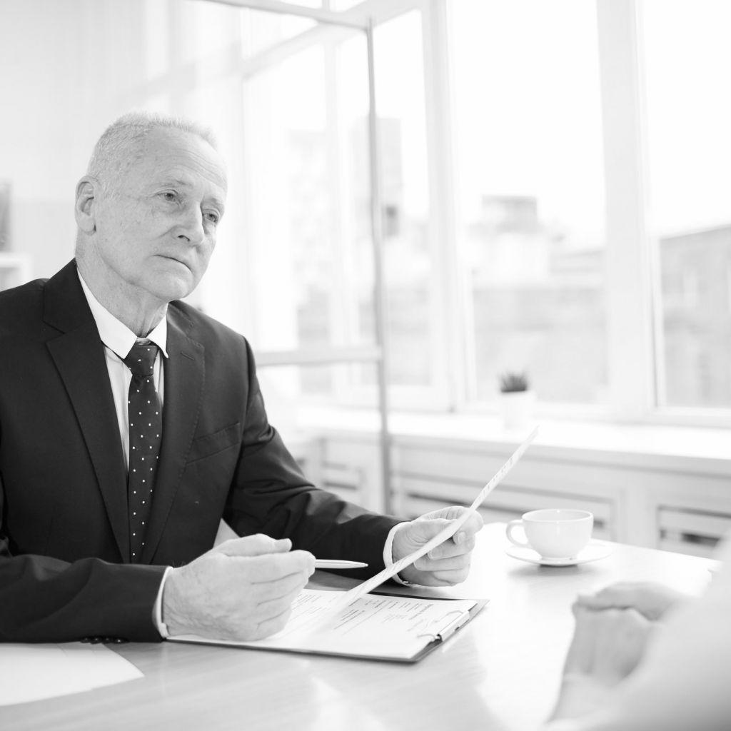 Senior Man Interviewing Job Candidate